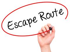 Man Hand writing Escape Route with black marker on visual screen Stock Photos