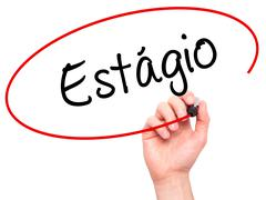 Man Hand writing Est????'Â?gio (Internship in Portuguese)  with black marke - stock photo