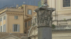 Gull cleaning its feathers on top of a pillar near Chiesa SS Nome di Maria, Rome Stock Footage