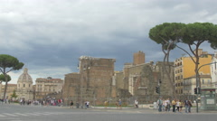 People, cars, bicycles and tricycles near Foro Traiano in Rome Stock Footage