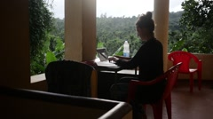 Girl working from tropical paradise on her laptop Stock Footage