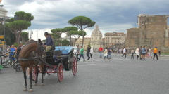 Horse carriage, cars, tricycle and people near Foro Traiano in Rome Stock Footage