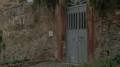 View of an ancient door with fresco in Rome - stock footage