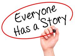 Man Hand writing Everyone Has a Story with black marker on visual screen Stock Photos