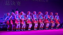 Women dressed in traditional minority dresses on stage in Guilin, China - stock footage