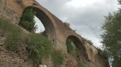 Beautiful view of arches of Roman ruins and plants in Rome - stock footage
