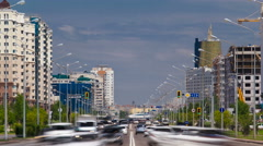 Traffic drives over the wide boulevards of Astana in Kazakhstan - stock footage