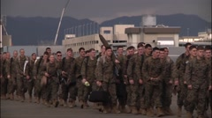 JAPAN, JANUARY 2016, US Soldiers Walk Terminal To Aircraft Stock Footage