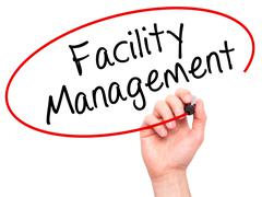 Man Hand writing Facility Management with black marker on visual screen - stock photo