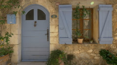 Light blue door and window with light blue shutters in Tourrettes-sur-Loup Stock Footage
