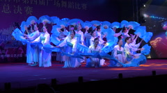 Classic Chinese dance performance, women wave fans, night, lights, show - stock footage