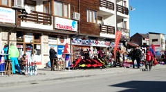 Street with shops with equipment for skiers and snowboarders in the resort Stock Footage