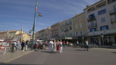 Walking near Trupheme and L'Occitane stores, in Saint-Tropez's port Stock Footage