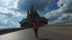Elephant Temple, Walkway, Woman Walking With Pink Backpack & Hat Stock Footage