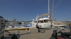Tourists relaxing in Quai Jean Jaurès, in Saint-Tropez's port Stock Footage
