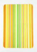 Laminated brightly colored striped table mat - stock photo