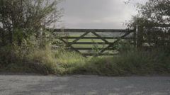 The Welsh Countryside Through Old Wooden Gate - stock footage
