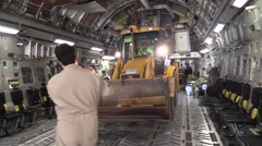 JAPAN, JANUARY 2016, Digger Drive Backwards In Cargo Area Aircraft Correct Stock Footage
