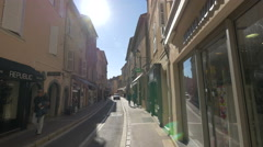 Walking and driving next to Republic Pull-In and Othello stores, in Saint-Tropez - stock footage