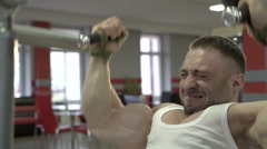 Stock Video Footage of Demonstration of the champion's profile doing exercises for bigger biceps