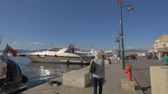 Walking on Quai Jean Jaurès, in the port of Saint-Tropez Stock Footage