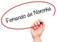 Man Hand writing Fernando de Noronha with black marker on visual screen Stock Photos