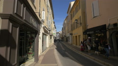 Driving and walking on Rue Général Allard, in Saint-Tropez Stock Footage