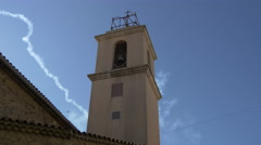 Plane flying above Eglise Sainte-Maxime's tower in Sainte-Maxime, France Stock Footage