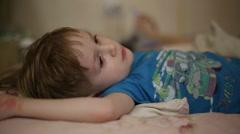 Little boy falls asleep - stock footage