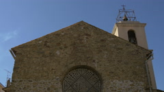 View of Eglise Sainte-Maxime's rosette and tower, France - stock footage