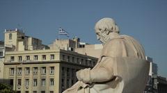 Scientist Plato Looks at the Greek Flag - stock footage