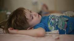 Little boy falls asleep Stock Footage