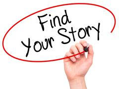 Man Hand writing Find Your Story with black marker on visual screen Stock Photos