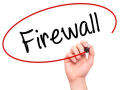 Man Hand writing Firewall  with black marker on visual screen - stock photo