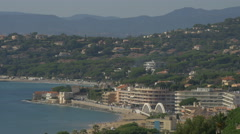 Amazing view of Sainte-Maxime's seaside with buildings and bridge, France Stock Footage