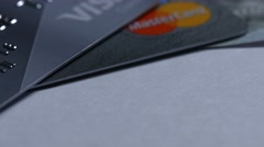 Macro close up dolly shot of  two major credit cards Visa and MasterCard ans Stock Footage