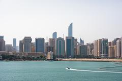 Sea front view with luxurious buildings in Abu Dhabi - stock photo