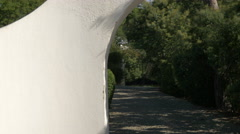 Alley leading to a gate in Sainte-Maxime, France Stock Footage