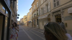 Walking on Rue Gambetta, next to the Pinko store, in Saint-Tropez Stock Footage