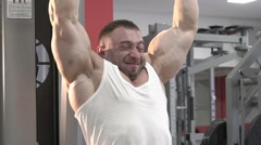 The champion of bodybuilding making hard exercise for arms and shoulders. Slowly - stock footage