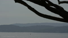 Sailing boat seen in the distance on the sea in Sainte-Maxime, France Stock Footage