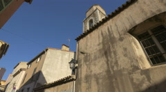 Old belfry seen from Rue Miséricorde, in Saint-Tropez Stock Footage