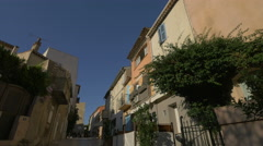 Rue Aire du Chemin with old buildings in Saint-Tropez Stock Footage
