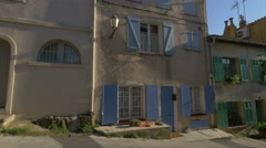 Old houses with blue and green shutters on a street in Saint-Tropez Stock Footage
