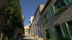 Old mediterranean houses with wooden shutters on a narrow street in Saint-Tropez Stock Footage