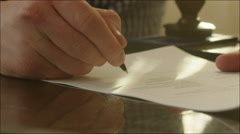Man Signing a Contract and Setting a Stamp Stock Footage