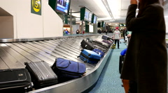 People waiting their luggage inside YVR Airport Stock Footage