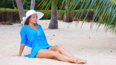Beach vacation. Hot beautiful woman in sunhat and bikini standing with her arms Stock Footage