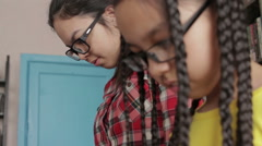 Two sisters with long hair in school library - stock footage