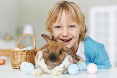 Ecstatic child and his pet Stock Photos